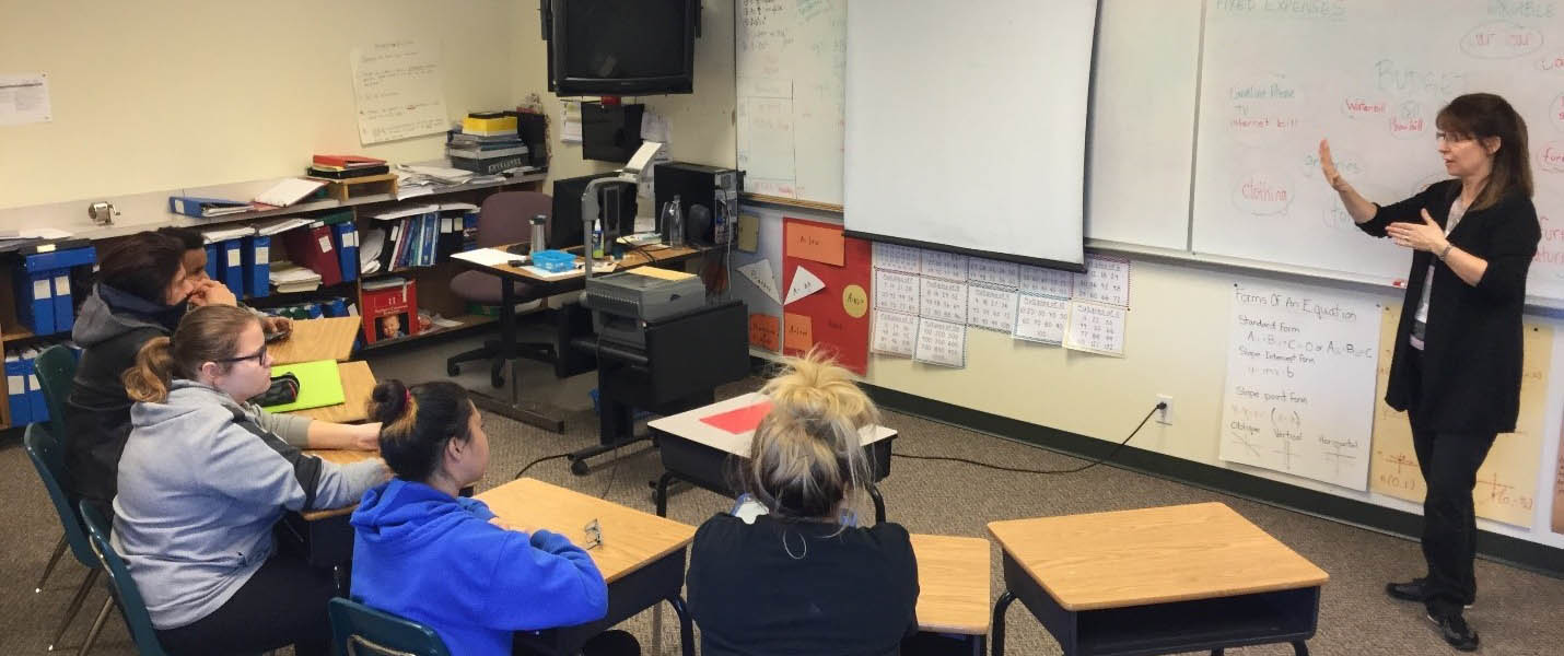 teacher using asl to teach math to students